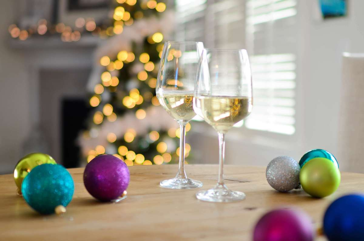 two-champagne-glasses-near-baubles-712324